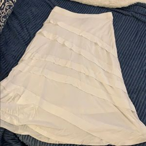 INC skirt with ruffle embellishment.